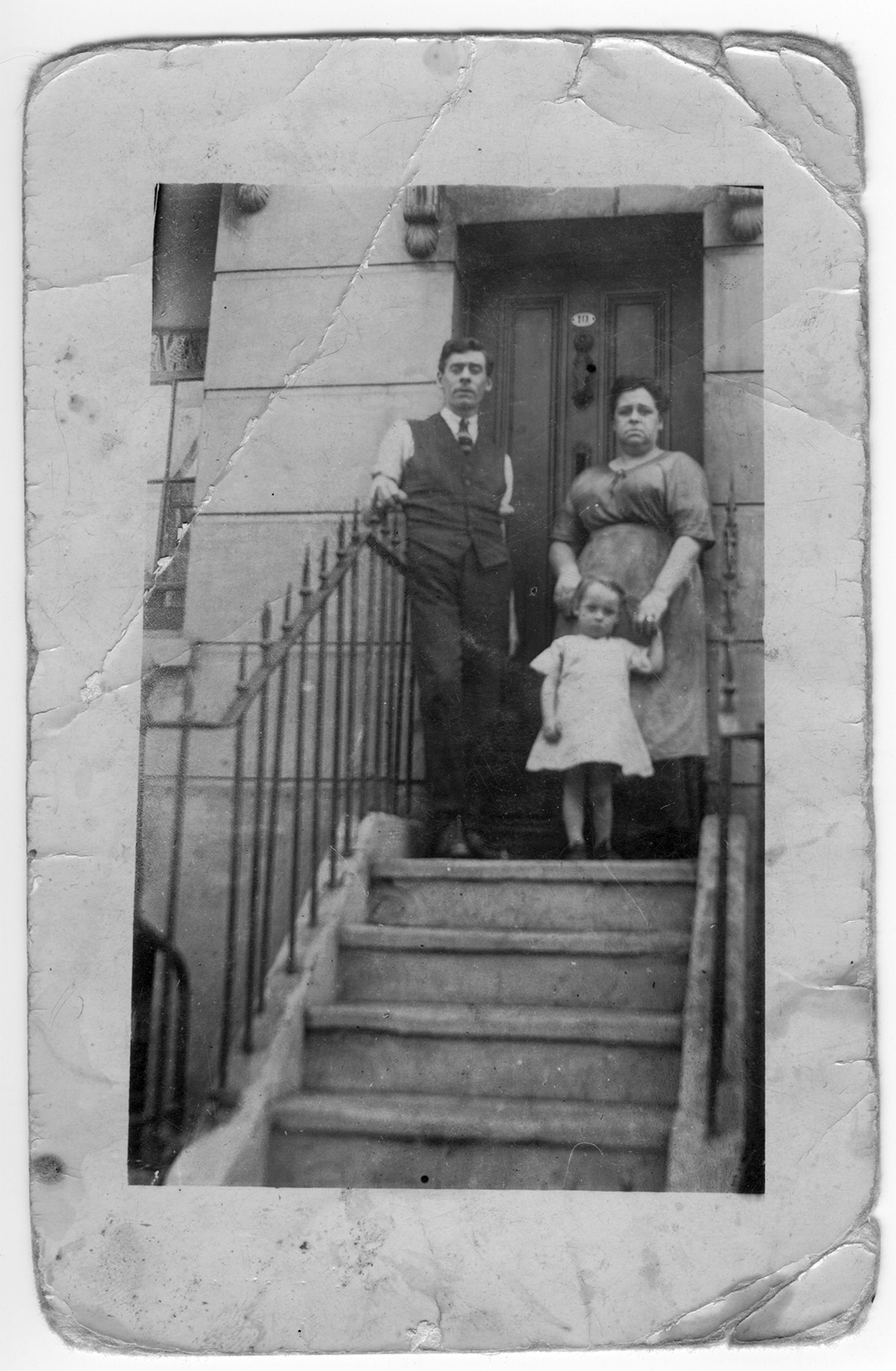 Old photograph family on house steps early 1900s