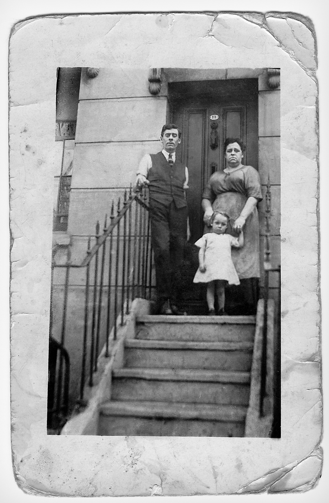 Retored photograph family on house steps  early 1900s